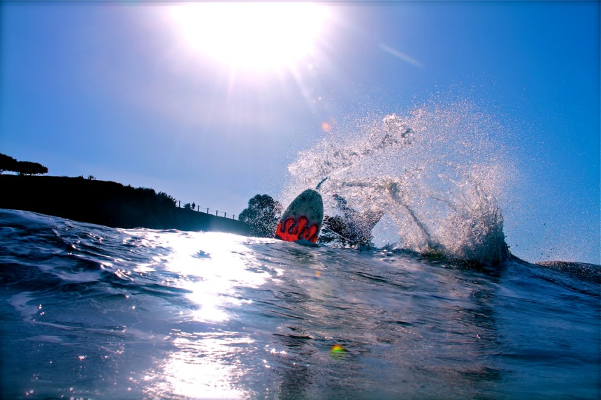 Shawn Tracht takes a water photo of Cameron Rigby in Shell Beach, California