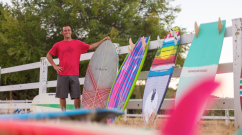 Photo: Shawn Tracht holding his original hand shape twinny fish...and hanging with a few other boards Photo: Paul Smith